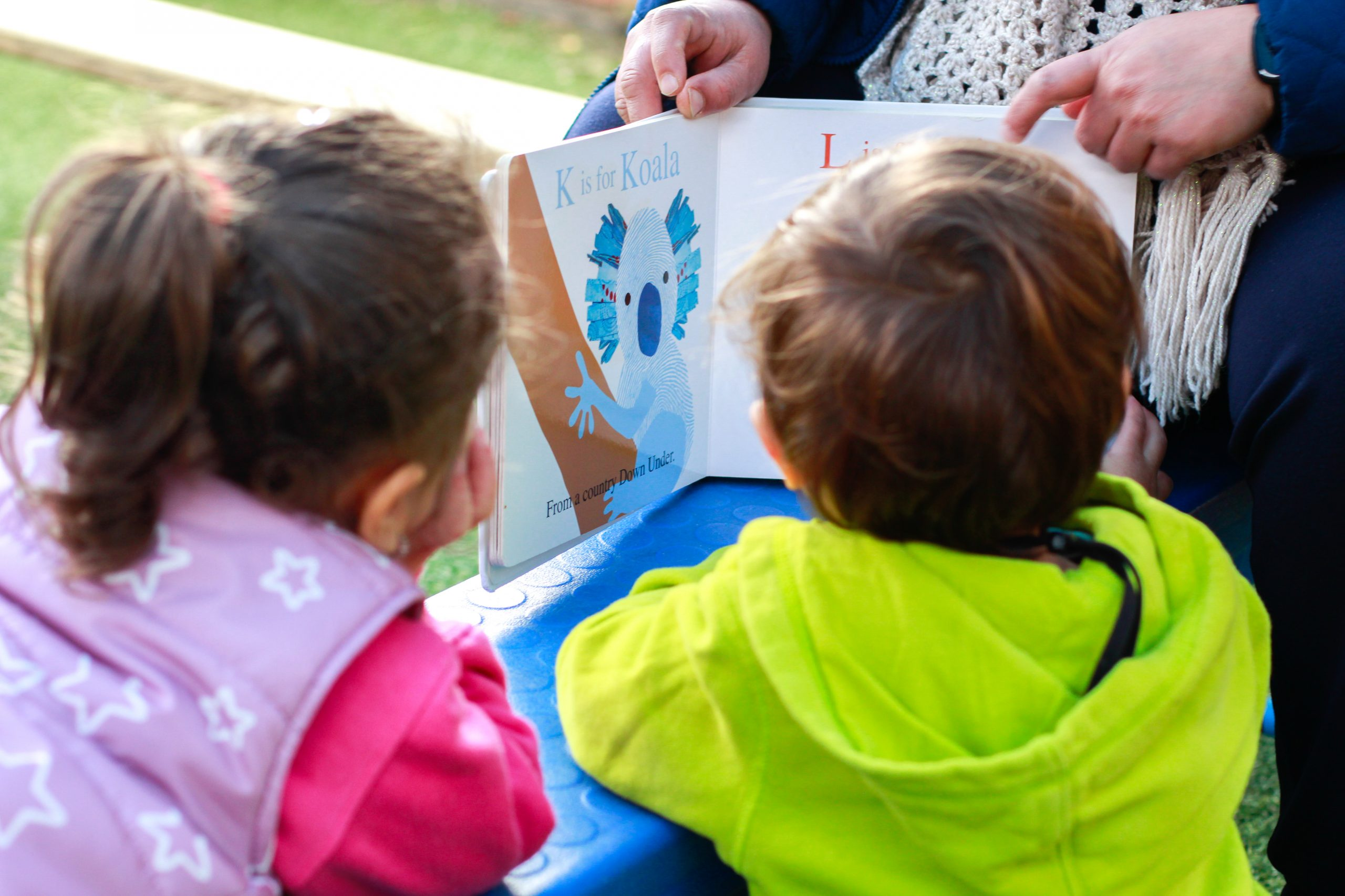 Kids reading book at Greystanes long day care centre
