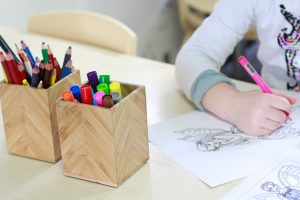 Kid drawing with textas